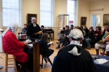 "Boston- March 5th, 2016- A young member of the audience joins Mike LePage (L), Paul Summers (C) and Ed Hurley (R) in the interactive play ""Trial of the Century"". The play is a part of the Old State House's program in commemoration of the Boston Massacre. (Marwa Morgan/BUNS)"